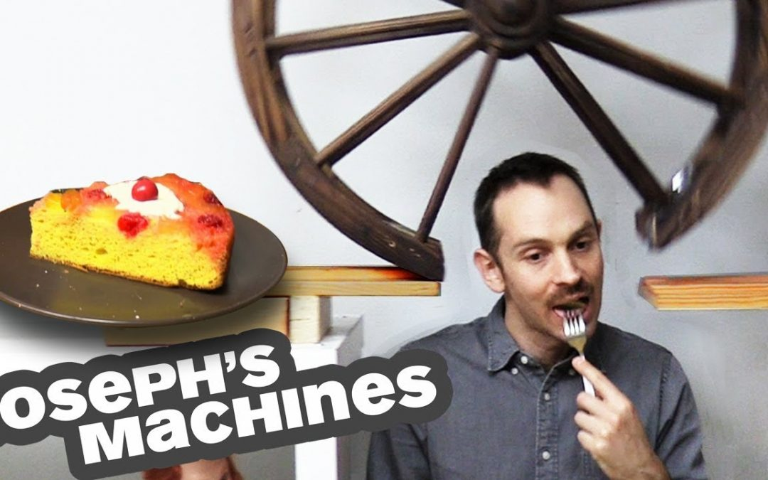 Kuchen durch eine geniale Kettenreaktions-Maschine servieren